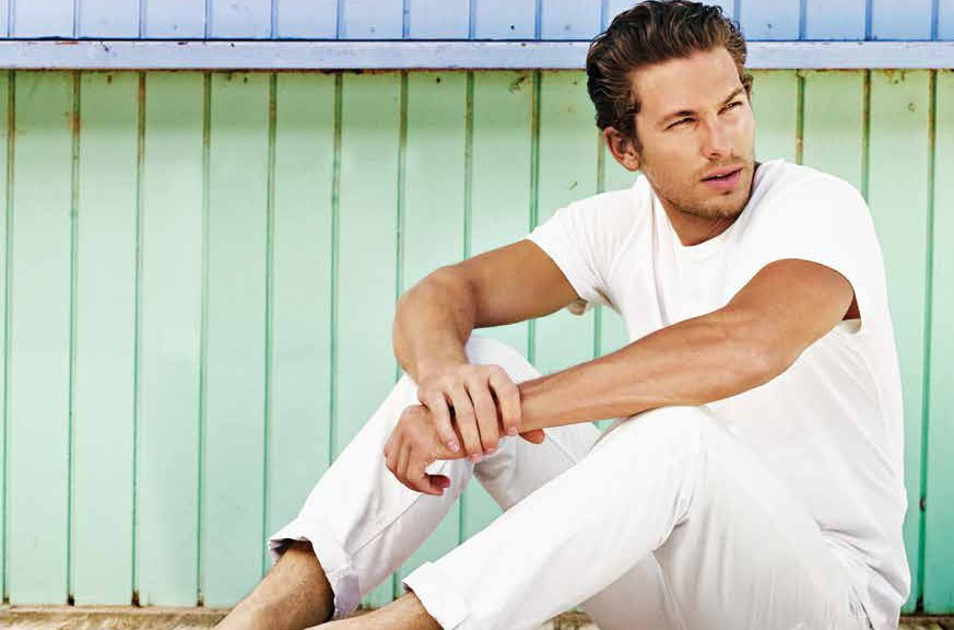 American model Adam Senn returns to the spotlight with the summer 2014 campaign of Australian label Ugg. Captured in a series of luminous daylight ads, the Dolce & Gabbana regular face embraces a relaxed wardrobe, made of basic cotton tees, white trousers and striped shorts, that capture the spirit of the brand's relaxed summer offering.