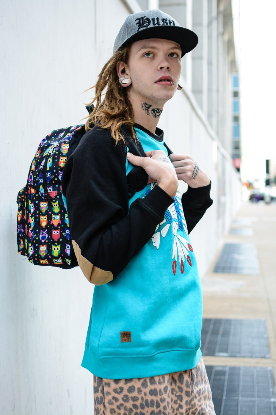 Wade by Calvin Brockington. Look 4: Cap: Cotton On Owl multi colored backpack: Star Point, By Mojo Indian Chief color blocked sweatshirt: Imperious Leopard printed sweatpants: 21 Men