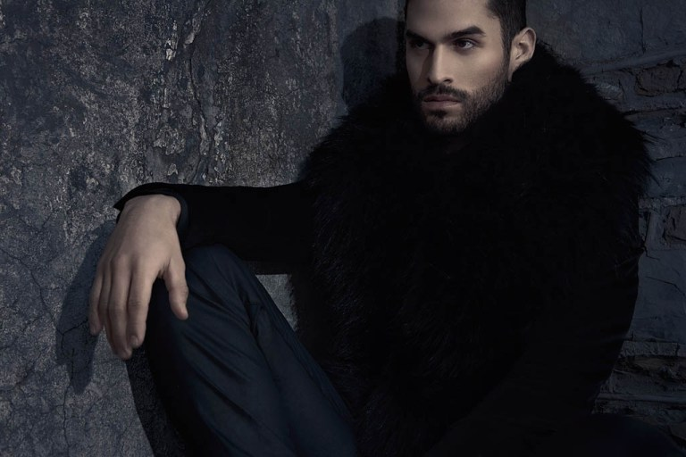 Orange Marketing model Omar Israel plays muse to fashion photographer David Zertuche for a new shoot that follows the modern style as a he gets ready for an outdoor session. Going from wearing nice long blanket and fake fur coat to sharp suiting from fur black vest, Omar embraces strong lines for quite the dashing outing, styled by Elié Rodriguez / Make up Artist Angelo Pegran.