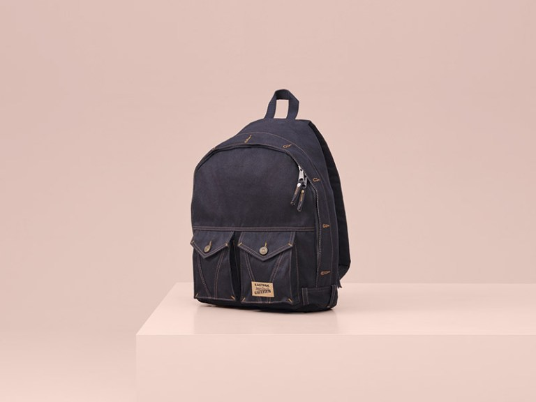 Denim Backpack -The jeans jacket in a recto/verso version – dark and light with overstitched pockets and button fastening.