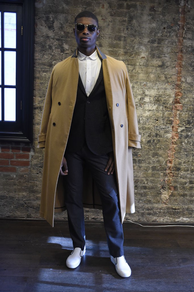 Inspired by New York City and London commuters, Bespoken successfully fused English tailoring with a street aesthetic. The highlights included deconstructed tailored jackets paired a boiled wool long coat, a monochromatic gray and plaid double-breasted suit over a turtleneck and a sporty neoprene blazer that can easily be paired with sweatpants or trousers.