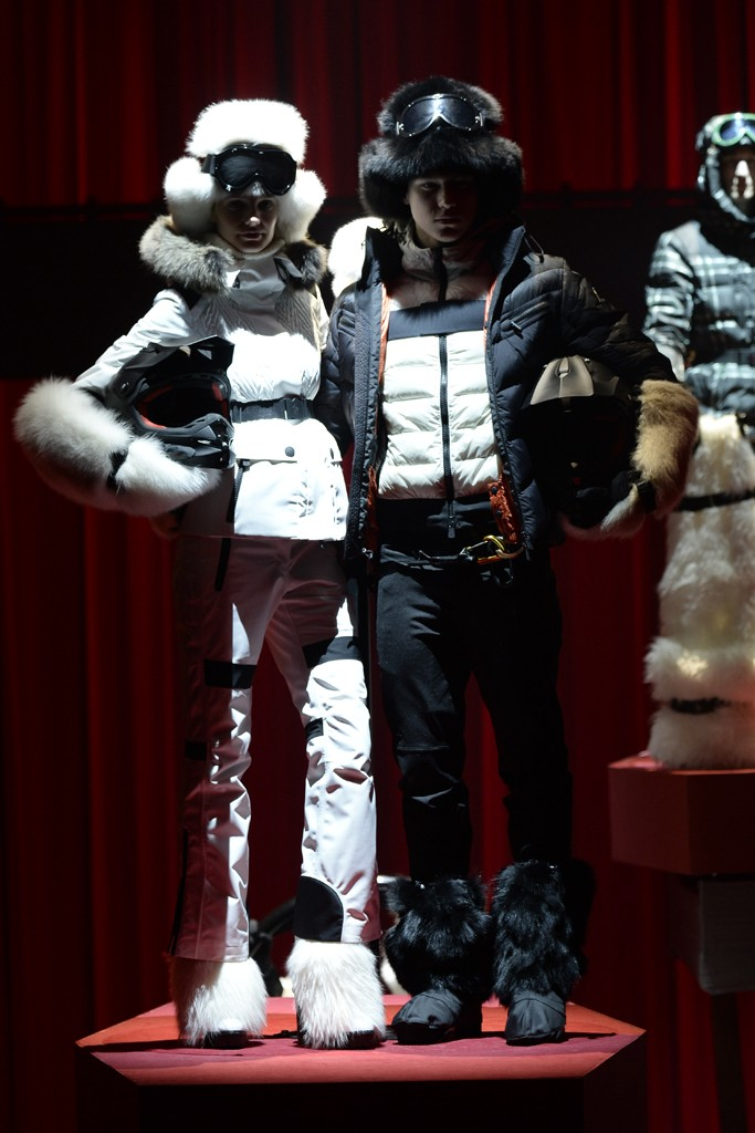 "This season, Moncler Grenoble focused on what it does best: technical, luxe ski outerwear for men and women that incorporated its unique interpretations of Mongolian fur, Norwegian wool and knits and flannel. In celebration of Valentine's Day, the brand called the collection ""Love Factory,"" and offered up a recurring red motif with Sixties and Seventies love songs playing in the background. Models were posed on moving platforms that lifted them from a larger-than-life, neon-red chocolate box. The finale: a bride draped in a quilted down gown and a groom in a down tuxedo adorned with tails."