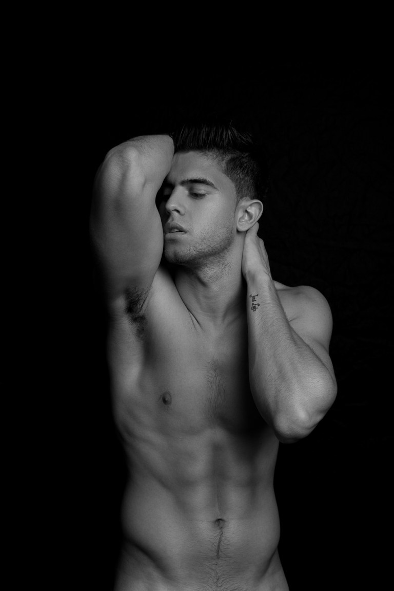Model Andre Brunelli at Front Management in a stunning black and white + color series captured by photographer Fritz Yap.