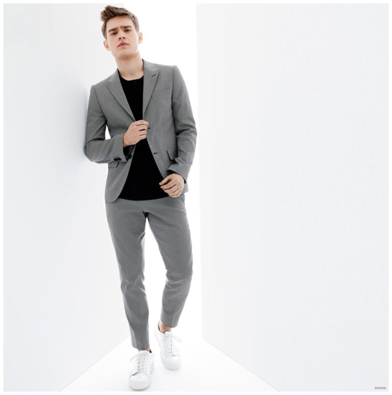 Bo Develius is back in the spotlight as he transitions from the sporty styles featured above to a more formal approach to everyday style. LE31 brings together slim lines with a graphic use of black and white. Simple looks such as a shirt and trousers are elevated with smart color blocking placement. Simons also has quite the sartorial moment with a black and white, double-breasted windowpane suit.