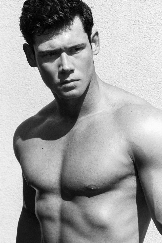 Fitness male model Brian Lewis showcases his muscular fit body to pose in front of the lens of talented Greg Vaughan, all inspirational black and white images where we can appreciate the real beauty of Brian.