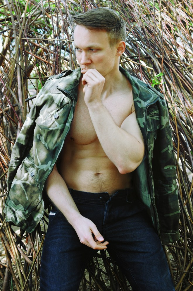 Polish model Karl Bloss in speedo and military jacket shoot in Warsaw by CES Photography.