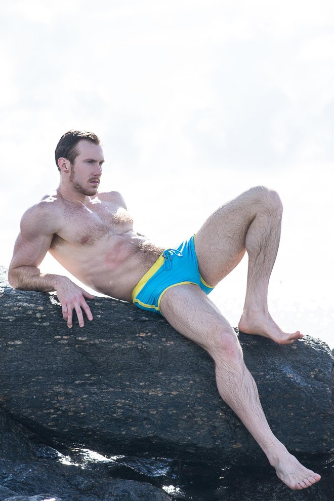Striking fit model Kevin Selby at Posche Models Miami posing for a splendid beach hot session by photographer Fritz Yap. Kevin's featuring Desmiit and Ilde Swimwear.