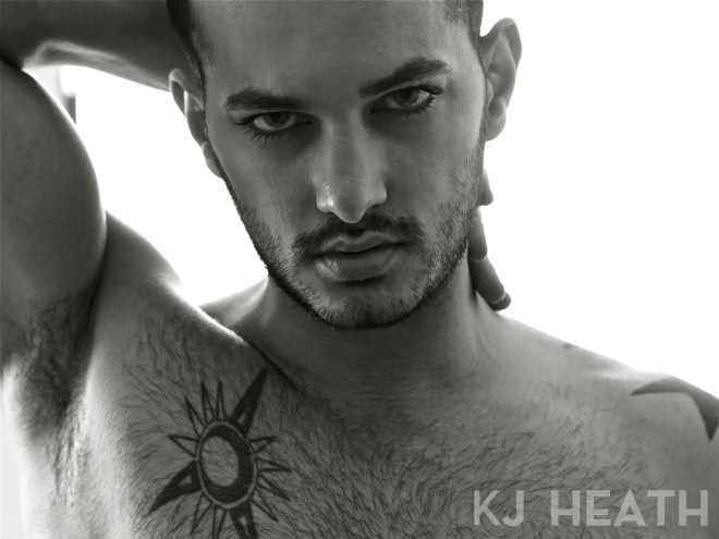Fresh off the lens by KJ Heat, we have sexy hunk male model Fabion Shkreli in a white and black portrait in bed.