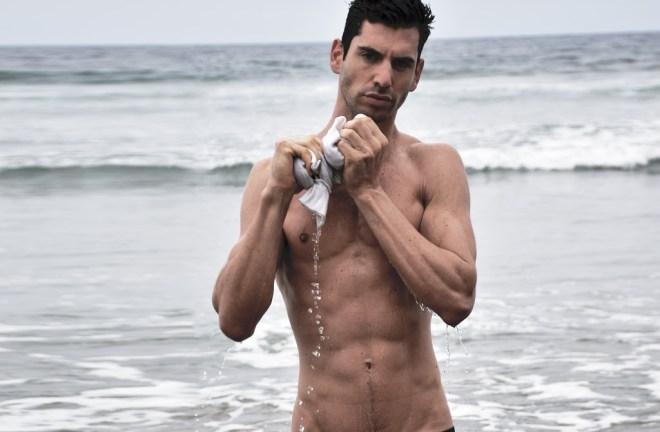Featuring male model Yotam Solomon posing in a beautiful beach snapped by Jordan Service.