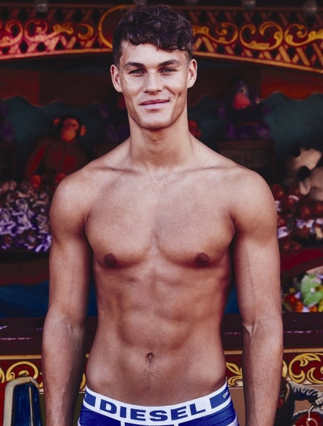 """Attitude Magazine September issue presents """"Hero Fit"""" a story where model Tyler Maher is playing in an amusement park wearing different underwear pieces all over the park."""