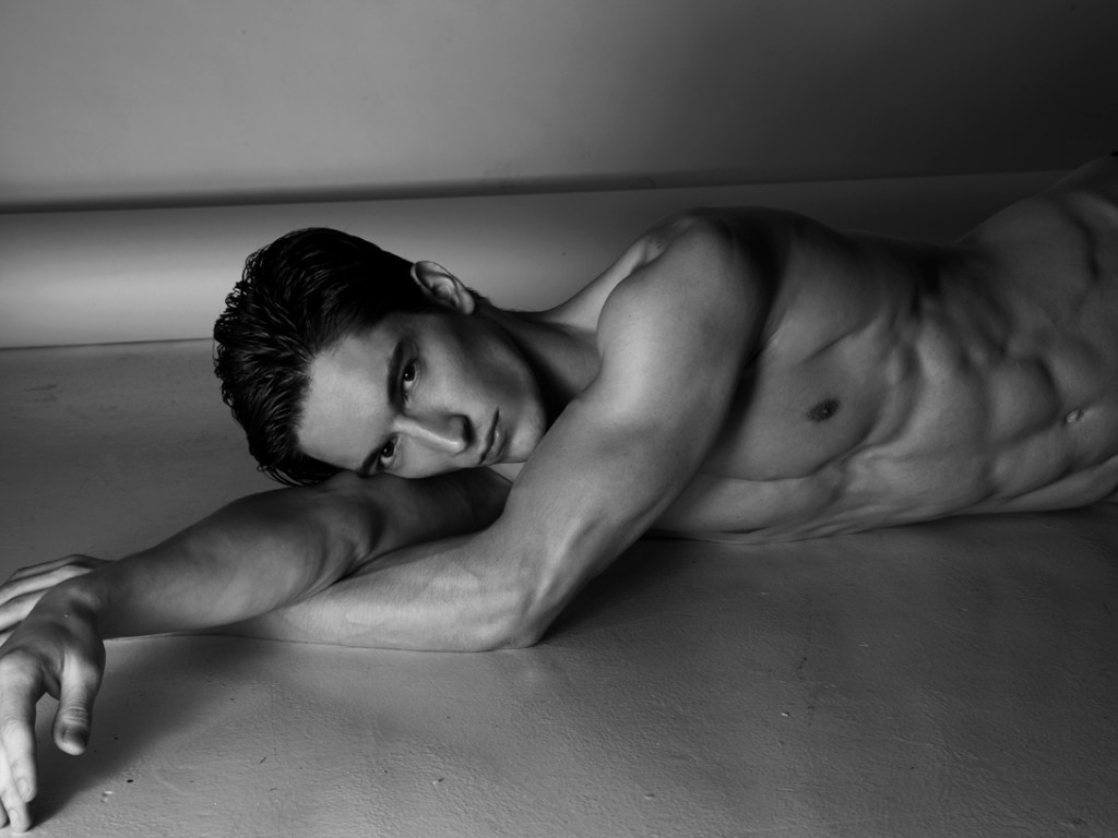 Exquisite portrait of model Stefan Radojkovic (represented by One Management) shot by Nino Yap an incredible work, highlighting his bare torso in black and white and also some color images included.