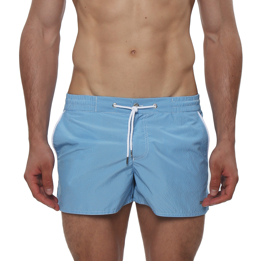 The Micro Gingham Barcelona Swim Trunk is a classic retro inspired swim trunk. This swim trunk has a sexy low-rise, contrast color piping, side pockets, fly front closure with a logo snap button, and full mesh lining.