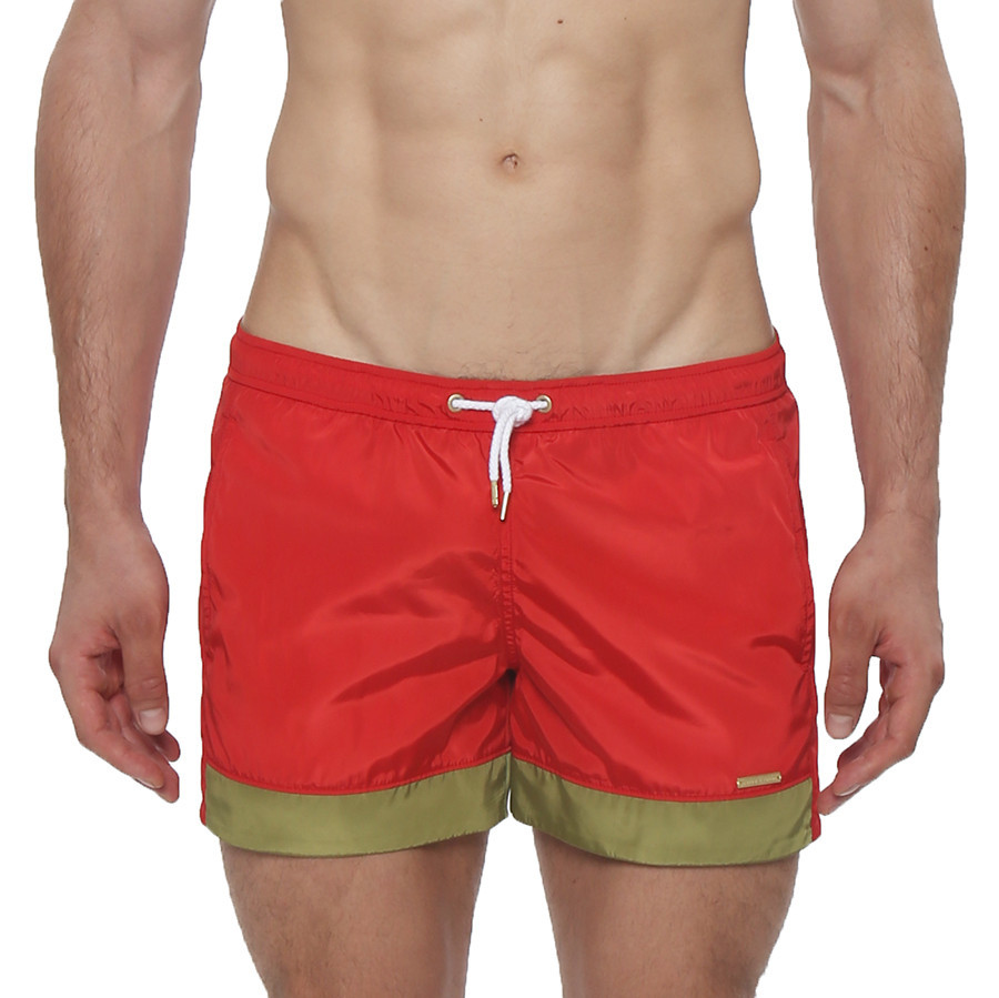 """A chic update to our classic 4"""" 70's inspired boardshort. The Colorblock Volley boardshort features a sexy low-rise, side pockets, elastic waistband, drawstring closure and full mesh lining."""