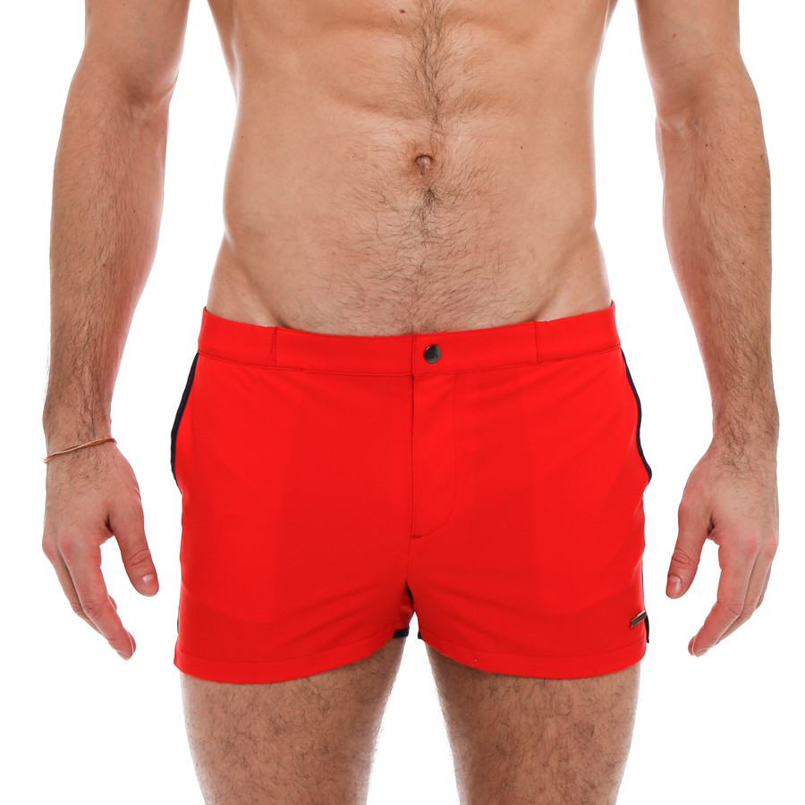 The Angeleno Swim Trunk is a retro inspired, square-cut with a 2 inch inseam. These bright color options will make a statement on the beach. This swim trunk has a sexy low-rise, contrast color piping, side pockets, fly front closure with a logo snap button, and full mesh lining.