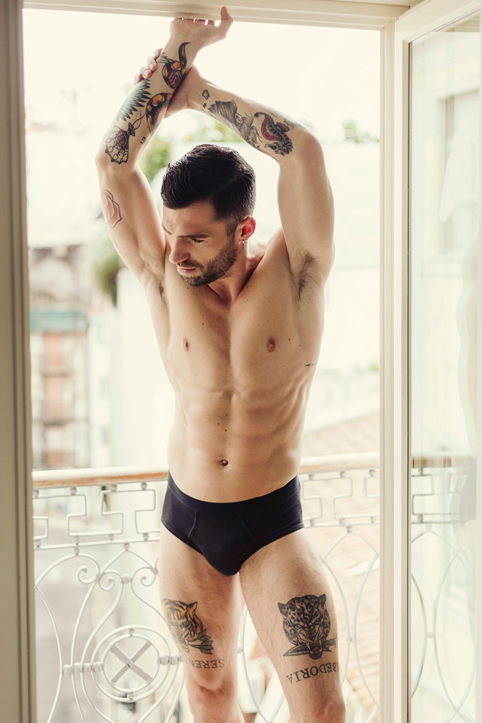 """You'd better looking for where I've got the word """"Serenidade"""" is tattooed on the beauty firm toned body of male model João Pombeiro photographed by David Velez."""