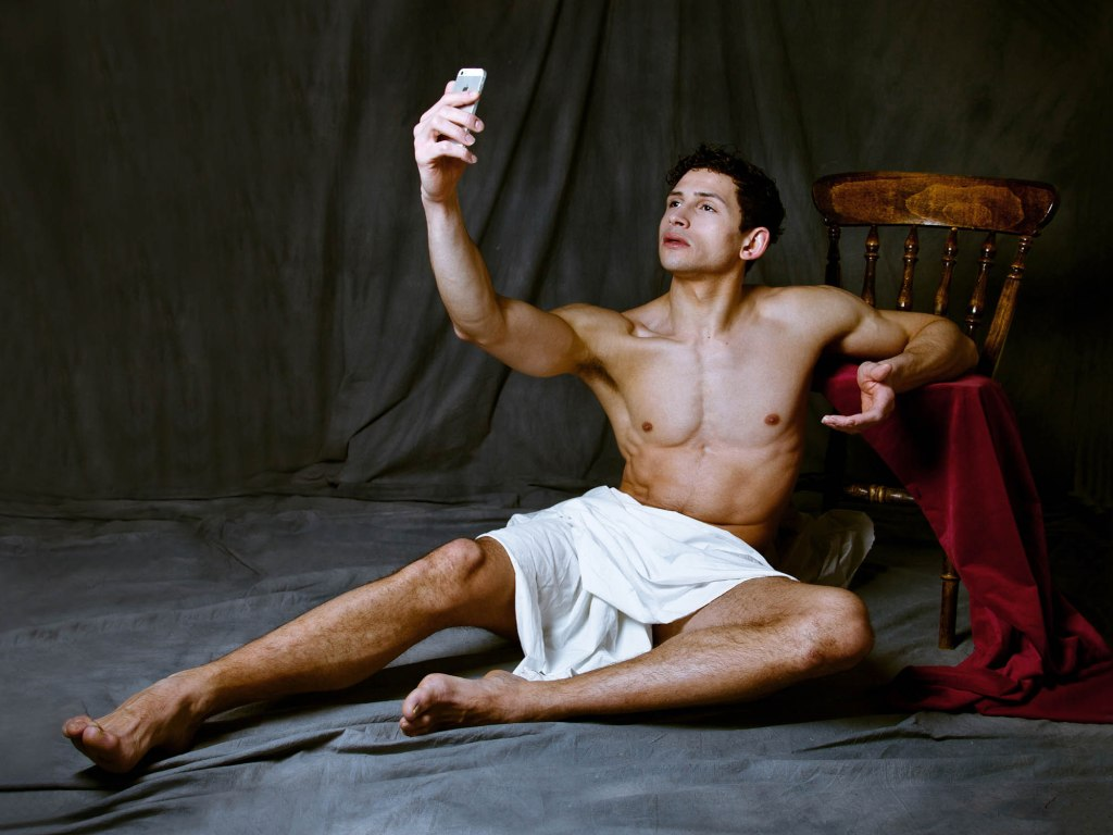 Scallywag Fox photographs Marlon Courbin for his series 'Cult of Beauty'. The series takes its influence from the Aesthetic Movement in art but these new photographs add a modern element showing the model on his iPhone taking selfies. Scallywag Fox is questioning our view on art and how we are consuming it in modern times compared with the late19th century. Can the traditional and the more instant sit side by side? More of Scallywag Fox's work can be seen at www.scallywagfox.com