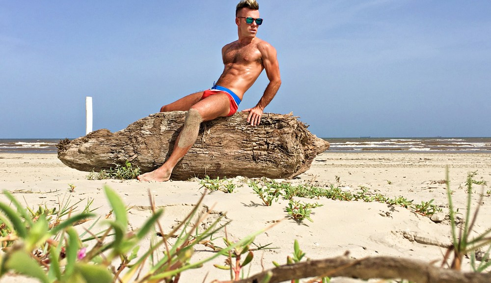 It's time to wear your sunglasses, speedos and sunscreen like DW Chase does in this shots by Vela Imagery for Wardrobe company Johnny Beach Buns.
