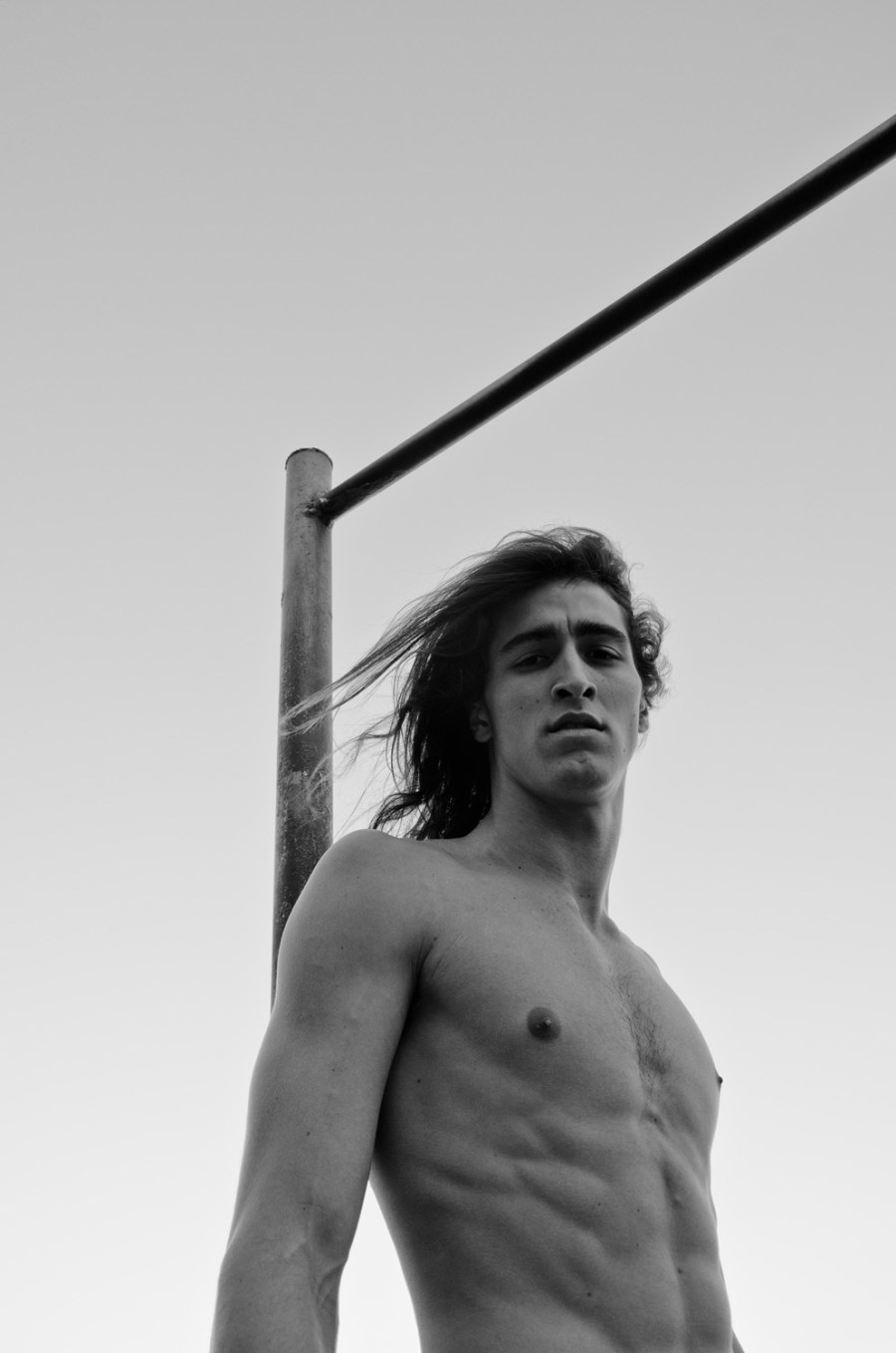 Long hair, don't care. That's the message behind today's jaw-dropping male model Rodrigo Hollinger, he's from 40 Graus Models. Ridiculously good-looking starts posing and stretching out on outdoors in Brazil with one thing and one thing only: Hair down to there. Photography by Felipe Pilotto.