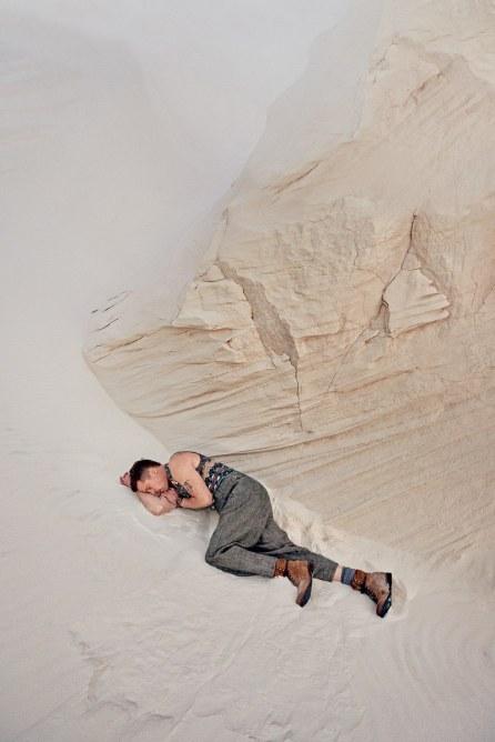 White Sands | Sweater-vest, $660, by Missoni / Pants, $1,595, by Giorgio Armani / Boots, $365, by Rag & Bone / Socks by Brunello Cucinelli / Watch by Tudor / Bracelet by Miansai