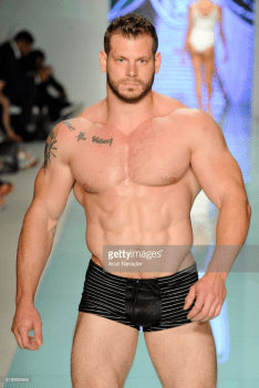 A model walks the runway during Mister Triple X at Miami Swim Week Art Hearts Fashion at FUNKSHION Tent on July 20, 2017 in Miami, Florida.