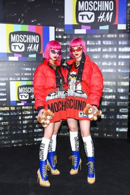 Ami Suzuki and Aya Suzuki of Amiaya attend the Moschino x H&M runway at Pier 36 on October 24, 2018 in New York City.