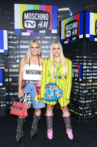 Bloggers Cailli Beckerman Sam Beckerman attends the Moschino x H&M runway at Pier 36 on October 24, 2018 in New York City.