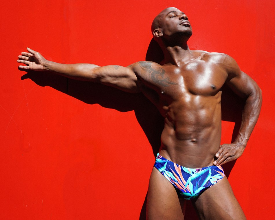 Men posing in Wapo Wear swimsuit