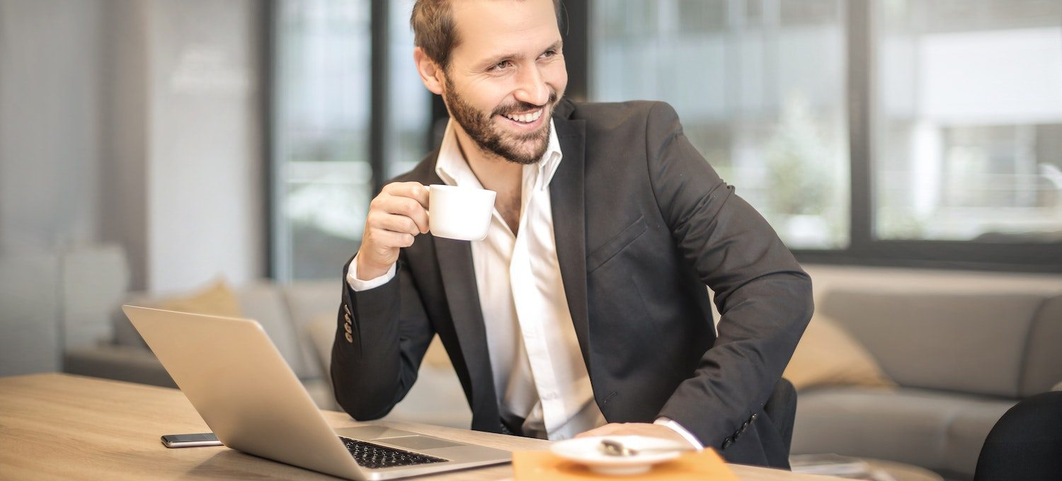 Business man taking a coffee