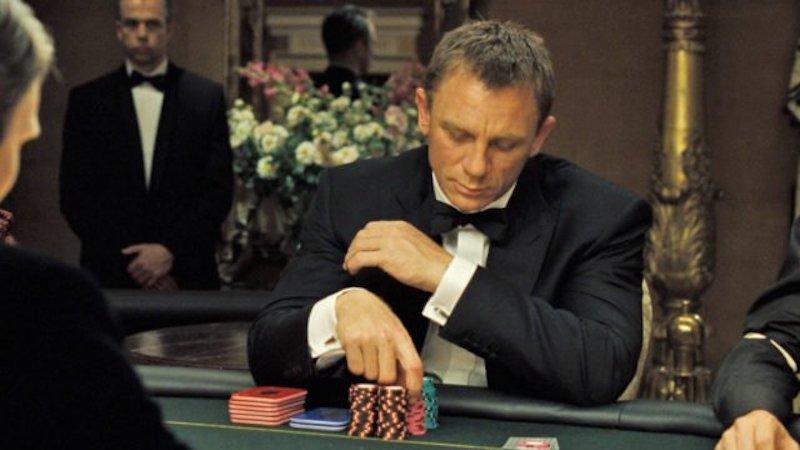 Daniel Craig wearing a black peaked lapel dinner suit in Casino Royale