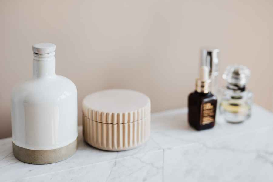 marble shelf for cosmetics storage in modern bathroom. Photo by Karolina Grabowska on Pexels.com