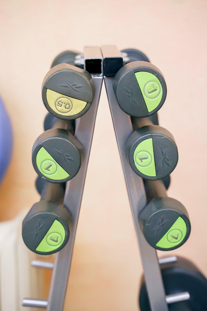 dumbbells placed on rack in gym. Photo by Kseniia Lopyreva on Pexels.com