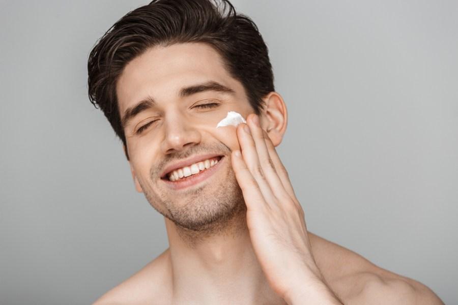 Man applying retinol for skincare