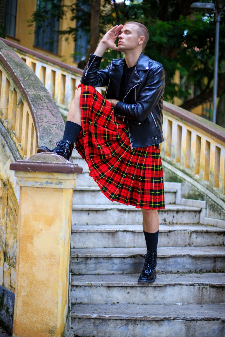 brutal male model in kilt on stairway. Photo by Reginaldo G Martins on Pexels.com