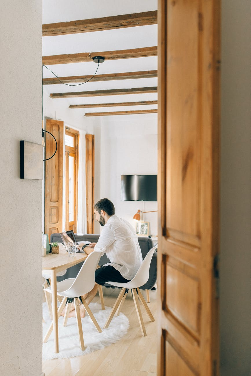 man working from home. Photo by Nataliya Vaitkevich on Pexels.com
