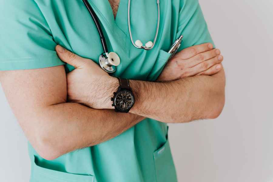 unrecognizable crop man in wristwatch with stethoscope. Photo by Karolina Grabowska on Pexels.com