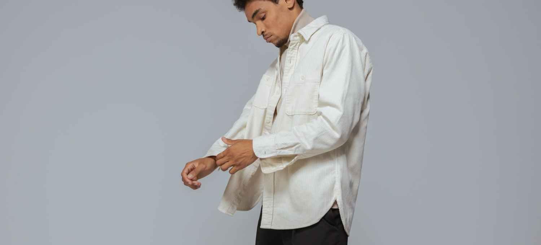 a man wearing a dress shirt over a turtleneck