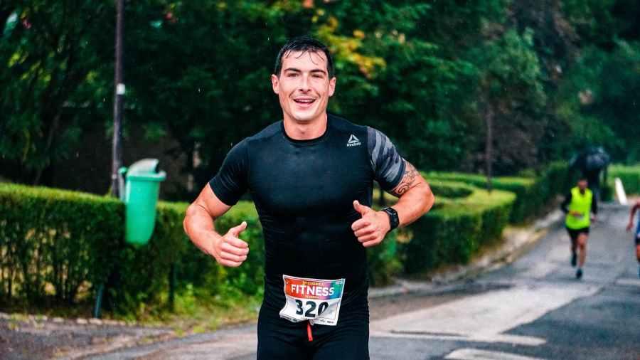 photo of a man running outdoors