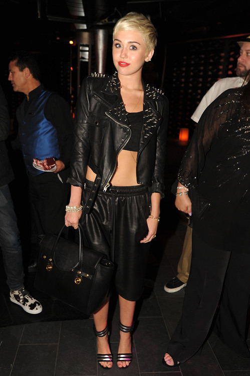 Get-the-Look-Miley-Cyrus-Pharrell-Williams-40th-Birthday-Party-Simone-Leather-Jacket-and-Saint-Laurent-Silver-and-Black-Striped-Sandals