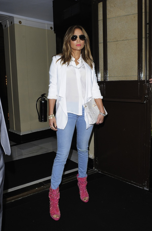 Jennifer Lopez poses up outside her London hotel wearing a pair of spiked florescent pink peep toe ankle boots before heading to the Captial Radio Studios in Leicester Square