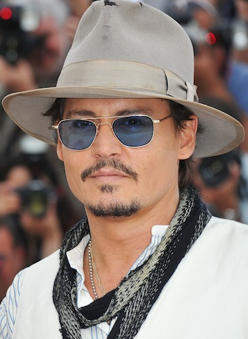 JOHNNY DEPP for pirates of caribbean in CANNES photo 3 pascal le segretain/getty on FashionDailyMag.com brigitte segura