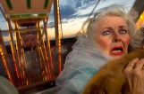 Old woman freaks out on ferris wheel.