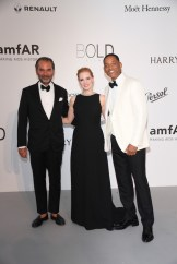 Remo Ruffini, Jessica Chastain and Will Smith arrive at the amfAR Gala Cannes 2017 at Hotel du Cap-Eden-Roc on May 25, 2017 in Cap d'Antibes, France