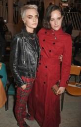 LONDON, ENGLAND - SEPTEMBER 16: Cara Delevingne (L) and Phoebe Waller-Bridge wearing Burberry at the Burberry September 2017 at London Fashion Week at The Old Sessions House on September 16, 2017 in London, England. Pic Credit: Dave Benett