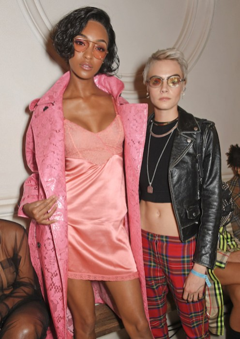 LONDON, ENGLAND - SEPTEMBER 16: Jourdan Dunn (L) and Cara Delevingne wearing Burberry at the Burberry September 2017 at London Fashion Week at The Old Sessions House on September 16, 2017 in London, England. Pic Credit: Dave Benett