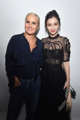 PARIS, FRANCE - SEPTEMBER 24: Maria Grazia Chiuri and Angela Baby pose backstage after the Christian Dior show as part of the Paris Fashion Week Womenswear Spring/Summer 2019 on September 24, 2018 in Paris, France. (Photo by Victor Boyko/Getty Images) *** Local Caption *** Maria Grazia Chiuri; Angela Baby