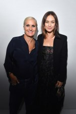 PARIS, FRANCE - SEPTEMBER 24: Maria Grazia Chiuri and Olga Kurylenko pose backstage after the Christian Dior show as part of the Paris Fashion Week Womenswear Spring/Summer 2019 on September 24, 2018 in Paris, France. (Photo by Victor Boyko/Getty Images) *** Local Caption *** Maria Grazia Chiuri; Olga Kurylenko