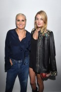 PARIS, FRANCE - SEPTEMBER 24: Maria Grazia Chiuri and Camille Rowe pose backstage after the Christian Dior show as part of the Paris Fashion Week Womenswear Spring/Summer 2019 on September 24, 2018 in Paris, France. (Photo by Victor Boyko/Getty Images) *** Local Caption *** Maria Grazia Chiuri; Camille Rowe