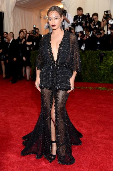 Queen Bey, Beyonce, rocks the red carpet in sheer black lace Givenchy Couture.