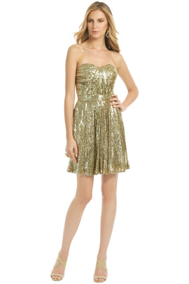 Feel and look ready for that extravaganza in this dazzling mini by Badgley Mischka.