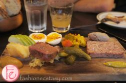 Ploughman's Platter with apple Butter, cheese, soft boiled eggs, house-smoked beef brisket, house-made pickles, Piccalilli, chicken liver pâté, pork terrine, country pork pâté & house made mustard by Riverside Public House